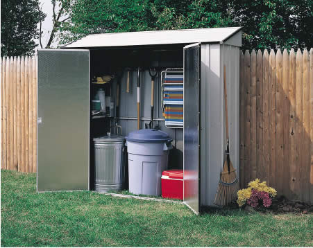 Arrow Storage Locker 7x2 Shed Kit CL72 assembled small shed in backyard