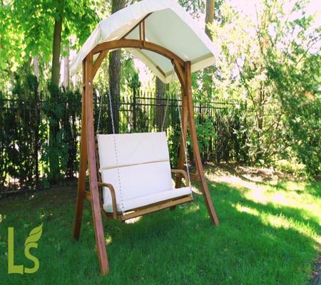 Leisure Season Wooden Swing Seater with Canopy (WSWC102) - swinging and relaxing in the yard